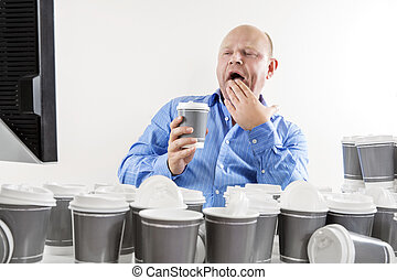 Yawning and tired businessman at office - Exhausted and...