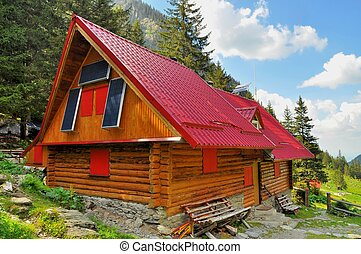 Mountain chalet with solar panels - Wooden mountain chalet...
