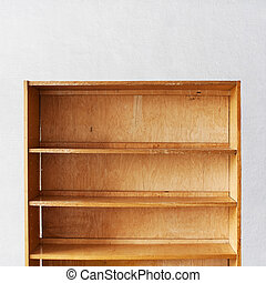 Wooden book Shelf near the stucco wall background