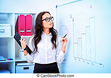presentation - Business woman making a presentation at the...