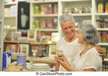 Senior couple in shopping center - Beautiful senior couple...