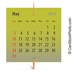 Calendar for May 2015 on a green sticker attached with...