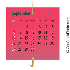 Calendar for September 2015 on a red sticker attached with...
