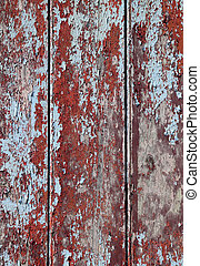 Rough peeling red and blue paint texture background.
