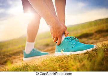 Runner with injured ankle - Runner leg and muscle pain...