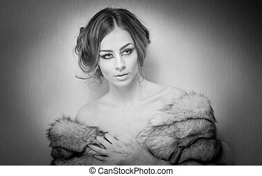 Beautiful woman in fur coat - Attractive sexy young woman...