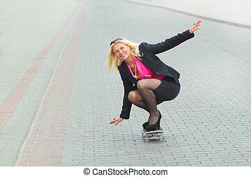Senior business woman having fun on a skateboard outdoors
