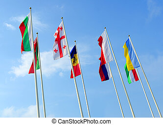 Flags of the different countries against the blue sky