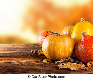 Autumn colored pumpkins on wooden table - Seasonal harvested...