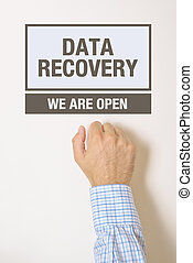 Businessman knocking on Data Recovery Office door looking...