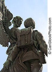 Angel and soldier statue - Statue of angel carrying soldier...