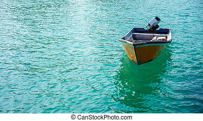 A boat floating on the sea surface