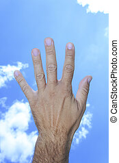 Hand showing five fingers in sky clouds background
