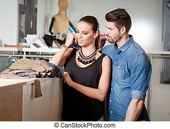 Young couple shopping - Portrait of attractive young couple...