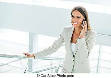 Confident businesswoman. Beautiful young businesswoman in...
