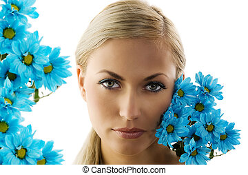 the blue daisy - close up of a young blond woman with blue...