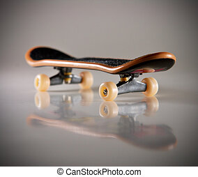 skateboard - Macro of fingerboard on light background with...