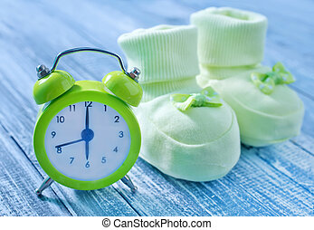 clock and baby socks
