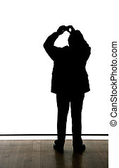 Silhouette of a man taking a picture