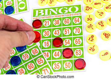 hand putting last chip to be winner of bingo game isolated...
