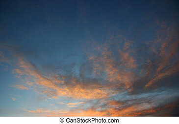 Clouds and sky at sunset - Dark orange clouds over blue sky...