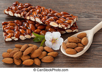 caramelized almonds - sweet caramelized almonds on dark wood...