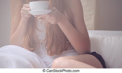Redhead girl with a cup of coffee - Beautiful redhead girl...