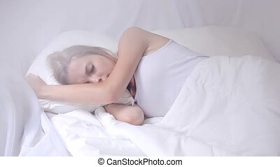 Girl with mobile phone in bed - Attractive girl sleeping...