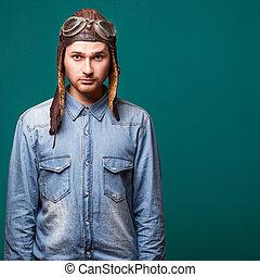 fashion male pilot in the studio