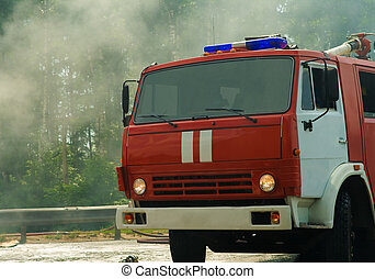 fire engine on the fire with smoke on background