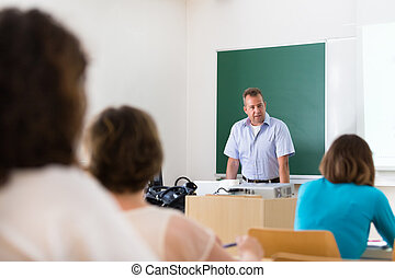 Lecturer at university. - Teacher at university in front of...