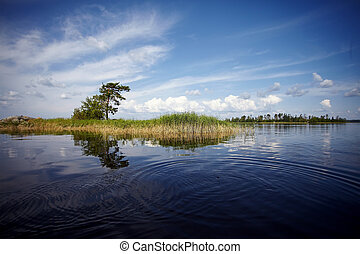Water landscape. The lake. Beautiful landscape. Water smooth...
