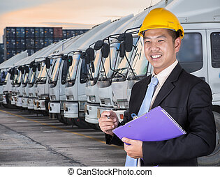 Transportation engineer with trucks of a transporting...