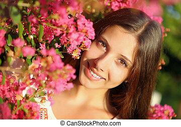 Young beautiful woman in flowers - Young beautiful woman...