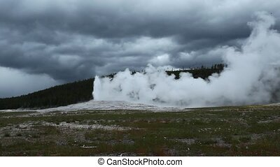 Old Faithful Geyser in Yellowstone - Old Faithful Geyser in...