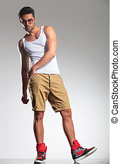 casual fit young man posing - casual fit young man having...
