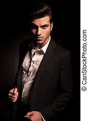 fashion man in suit pulling his coat - cool fashion man in...