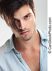 Casual young man on gray background - Photo of a casual...