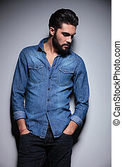 Man with hand in pocket - Handsome man in blue shirt posing...