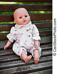 Baby Doll - Alone baby doll sitting in the park.