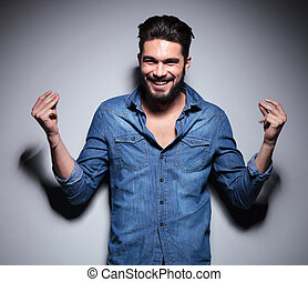 Man smilling and moving his hands - Handsome man in blue...