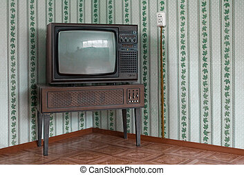 Retro tv set - Retro grunge tv against wallpaper wall.