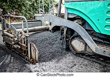 detail of asphalt paver machine during road construction and...