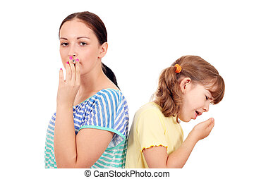 little girl coughing due to smoke