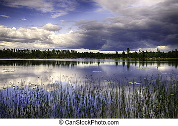 Swedish Landscape - A beautiful lake in Sweden with clouds...