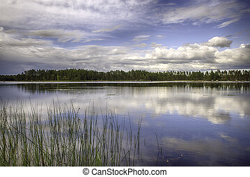 Swedish Landscape - A beautiful lake in Sweden with cloud's...