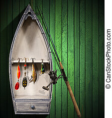 Fishing Tackle - Small Boat - Green wooden background with...