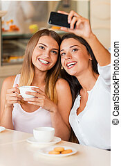 Great place for selfie! Two attractive young women making...