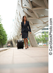 Business woman traveling with suitcase - Portrait of a...