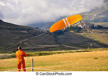 Man doing paragliding in the Apennines landscapes - Italian...